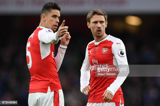 Nacho Monreal of Arsenal and Gabriel of Arsenal speak prior to the Premier League match between Arsenal and Leicester City at the Emirates Stadium on...