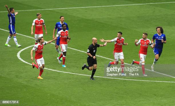 Nacho Monreal of Arsenal and Granit Xhaka of Arsenal appeals to referee Anthony Taylor during the Emirates FA Cup Final between Arsenal and Chelsea...