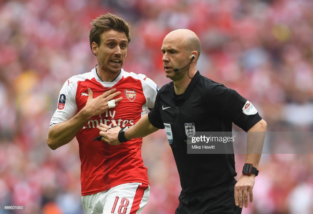 Nacho Monreal of Arsenal appeals to referee Anthony Taylor during The Emirates FA Cup Final between Arsenal and Chelsea at Wembley Stadium on May 27, 2017 in London, England.