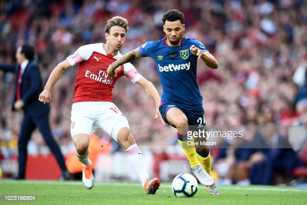 Nacho Monreal of Arsenal battles for posession with Ryan Fredericks of West Ham United during the Premier League match between Arsenal FC and West...