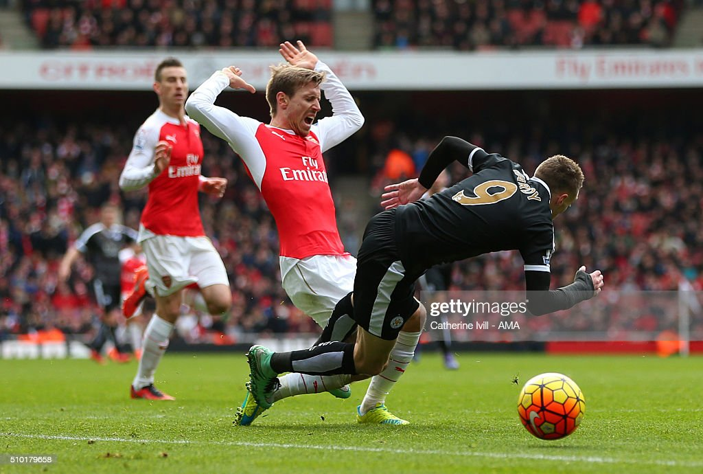 Nacho Monreal of Arsenal brings down Jamie Vardy of Leicester City in the penalty area during the Barclays Premier League match between Arsenal and Leicester City at the Emirates Stadium on February 14, 2016 in London, England.