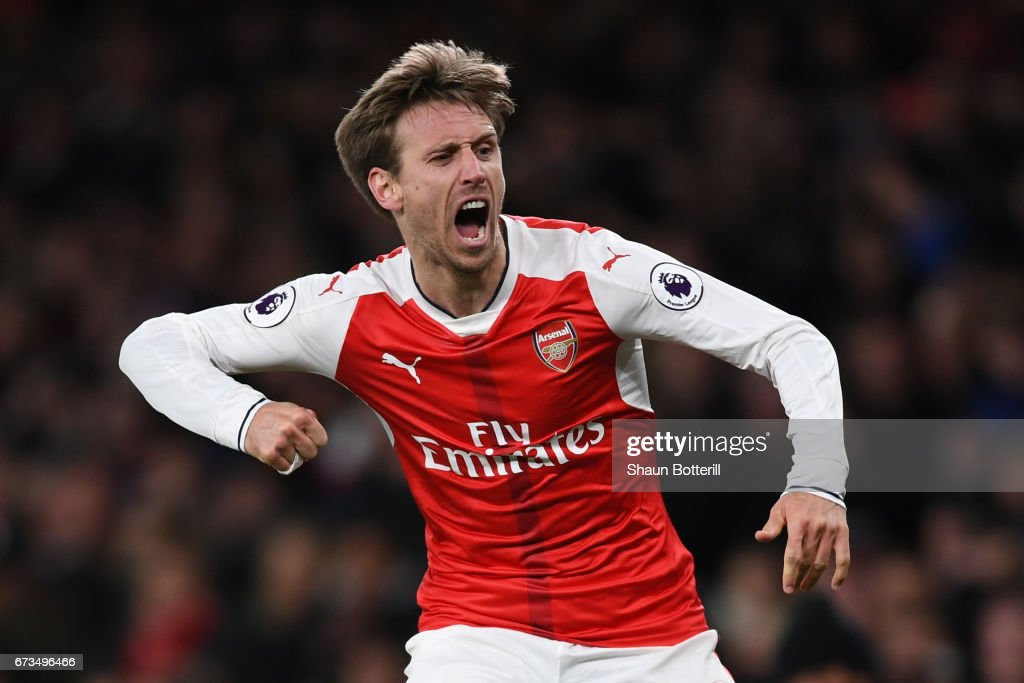 Nacho Monreal of Arsenal celebrates after his shot was deflceted onto Robert Huth of Leicester City (Not pictured) leading to Arsenal's first goal during the Premier League match between Arsenal and Leicester City at the Emirates Stadium on April 26, 2017 in London, England.