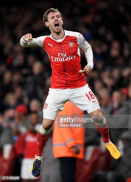 Nacho Monreal of Arsenal celebrates after his shot was deflceted onto Robert Huth of Leicester City leading to Arsenal's first goal during the...