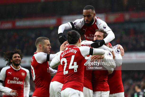 Nacho Monreal of Arsenal celebrates after scoring his sides first goal with his Arsenal team mates during the Premier League match between Arsenal...