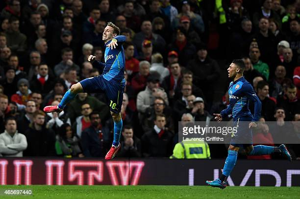 Nacho Monreal of Arsenal celebrates after scoring the opening goal with teammate Alex OxladeChamberlain of Arsenal during the FA Cup Quarter Final...