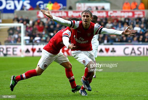Nacho Monreal of Arsenal celebrates his goal during the Barclays Premier League match between Swansea City and Arsenal at Liberty Stadium on March...