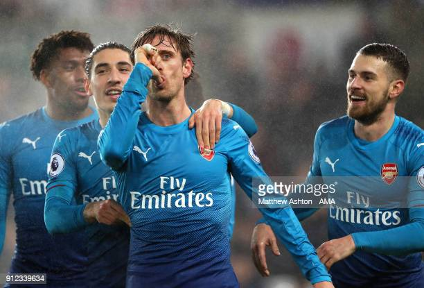 Nacho Monreal of Arsenal celebrates scoring a goal to make the score 0-1 during the Premier League match between Swansea City and Arsenal at Liberty...