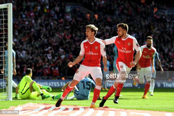 Nacho Monreal of Arsenal celebrates scoring his sides first goal during the Emirates FA Cup SemiFinal match between Arsenal and Manchester City at...
