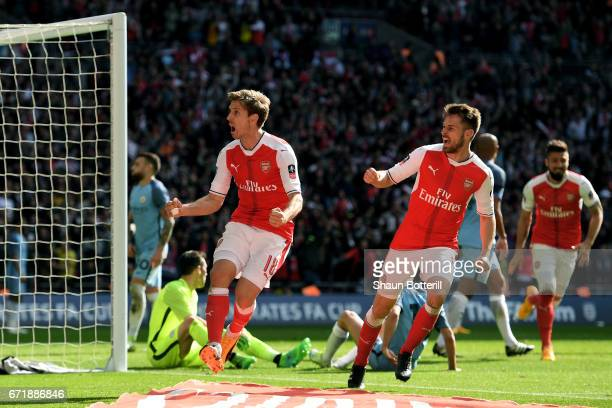 Nacho Monreal of Arsenal celebrates scoring his sides first goal during the Emirates FA Cup Semi-Final match between Arsenal and Manchester City at...