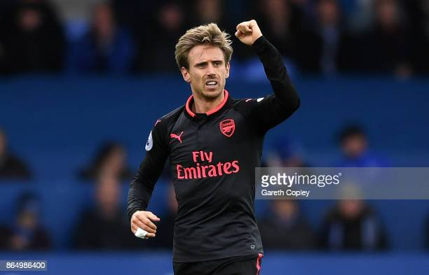 Nacho Monreal of Arsenal celebrates scoring his sides first goal during the Premier League match between Everton and Arsenal at Goodison Park on...