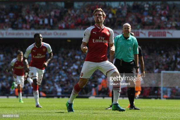Nacho Monreal of Arsenal celebrates scoring his side's first goal during the Premier League match between Arsenal and West Ham United at Emirates...