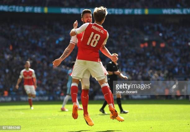 Nacho Monreal of Arsenal celebrates scoring his sides first goal with his team mate Olivier Giroud during the Emirates FA Cup Semi-Final match...