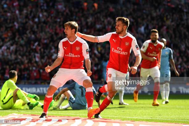 Nacho Monreal of Arsenal celebrates scoring his sides first goal with his team mate Aaron Ramsey during the Emirates FA Cup Semi-Final match between...