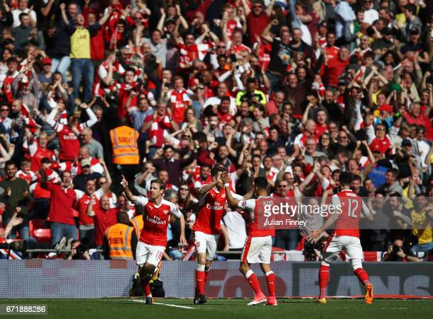 Nacho Monreal of Arsenal celebrates scoring his sides first goal with his team mates during the Emirates FA Cup SemiFinal match between Arsenal and...