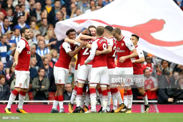 Nacho Monreal of Arsenal celebrates scoring his sides first goal with his Arsenal team mates during the Premier League match between Arsenal and...