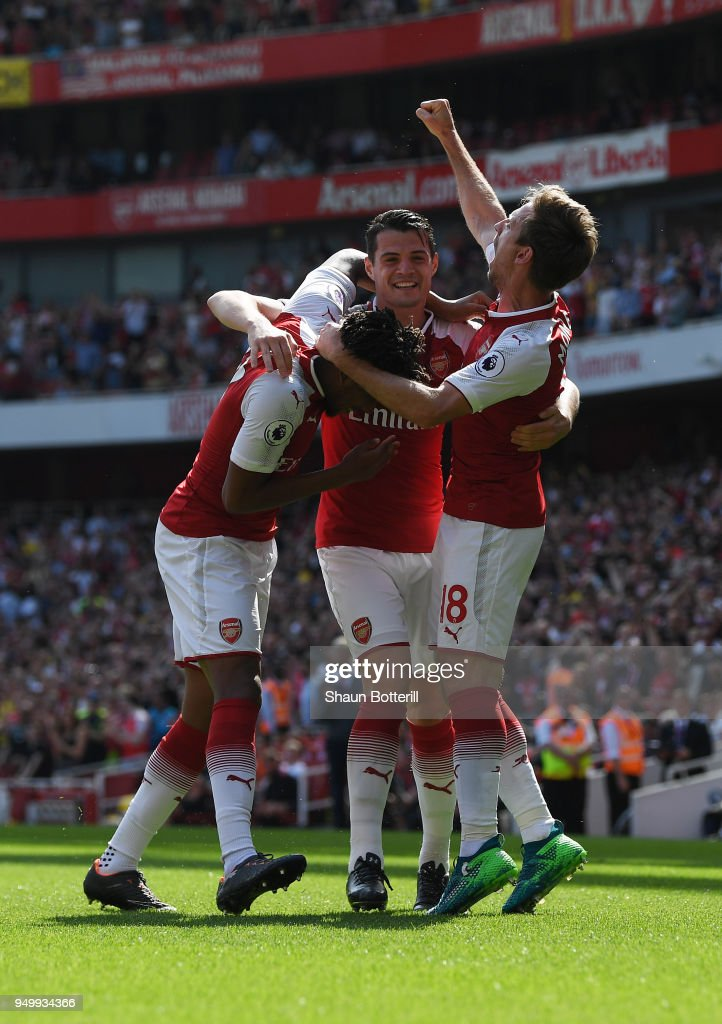 Nacho Monreal of Arsenal celebrates scoring his side's first goal with Granit Xhaka and Alex Iwobi during the Premier League match between Arsenal and West Ham United at Emirates Stadium on April 22, 2018 in London, England.