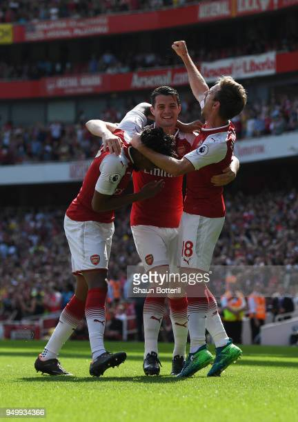 Nacho Monreal of Arsenal celebrates scoring his side's first goal with Granit Xhaka and Alex Iwobi during the Premier League match between Arsenal...