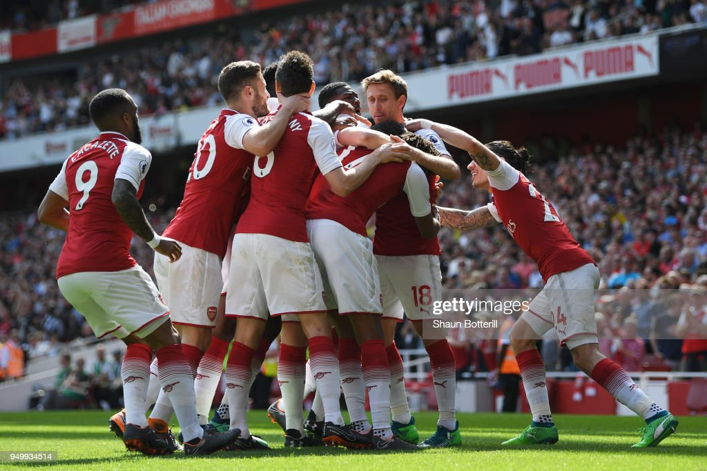 Nacho Monreal of Arsenal celebrates scoring his side's first goal with team mates during the Premier League match between Arsenal and West Ham United at Emirates Stadium on April 22, 2018 in London, England.