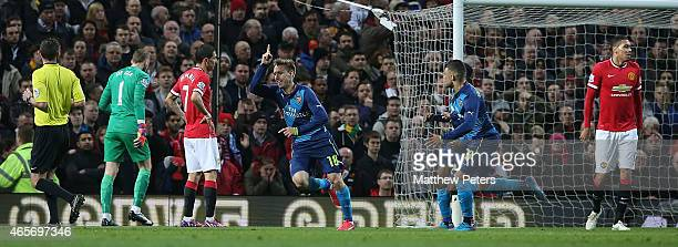 Nacho Monreal of Arsenal celebrates scoring their first goal during the FA Cup Quarter Final match between Manchester United and Arsenal at Old...