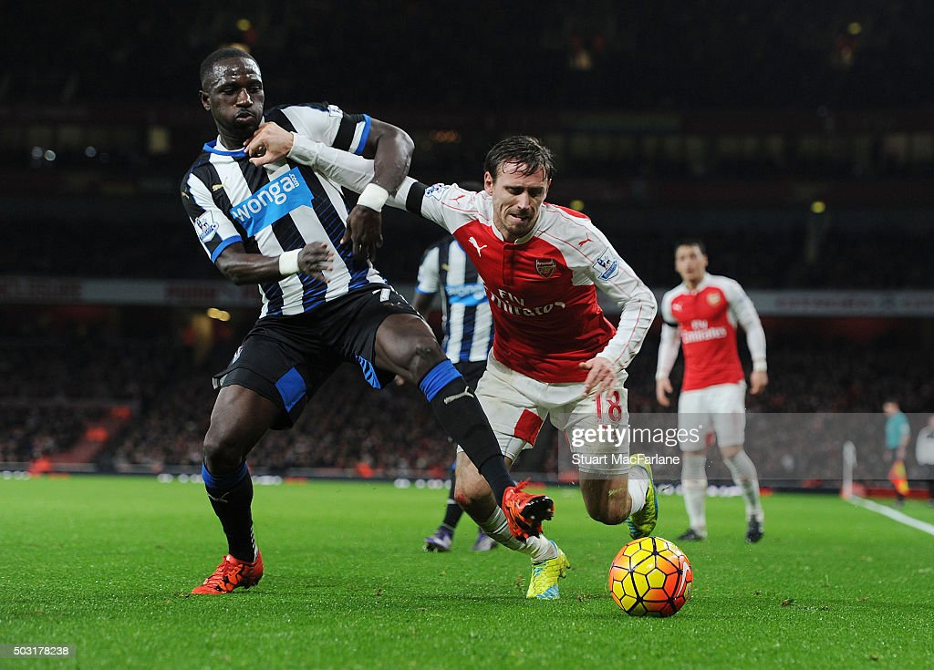 Nacho Monreal of Arsenal challenged by Moussa Sissoko of Newcastle during the Barclays Premier League match between Arsenal and Newcastle United at Emirates Stadium on January 2, 2016 in London, England.