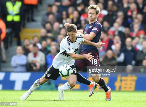 Nacho Monreal of Arsenal challenges AndreFrank Zambo Anguissa of Fulham during the Premier League match between Fulham FC and Arsenal FC at Craven...
