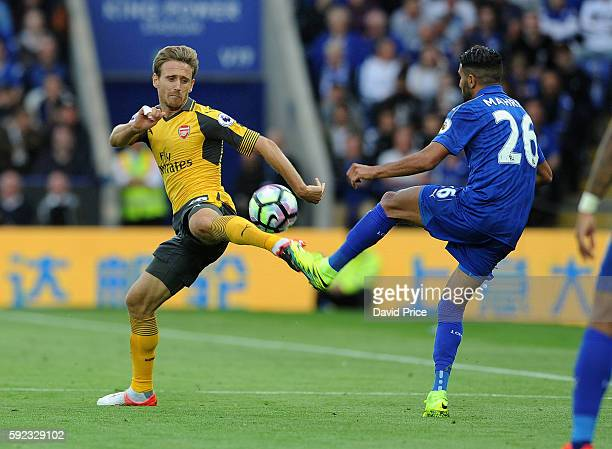 Nacho Monreal of Arsenal challenges Riyad Mahrez of Leicester during the Premier League match between Leicester City and Arsenal at The King Power...