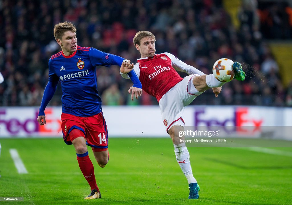 Nacho Monreal of Arsenal clears the ball against Kirill Nababkin of CSKA Moskva during the UEFA Europa League quarter final leg two match between CSKA Moskva and Arsenal FC at CSKA Arena on April 12, 2018 in Moscow, Russia.