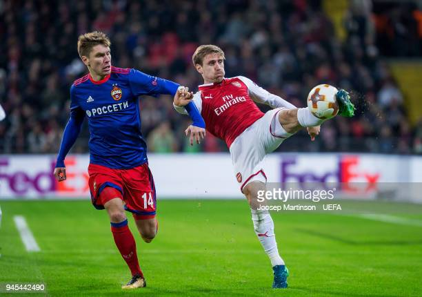 Nacho Monreal of Arsenal clears the ball against Kirill Nababkin of CSKA Moskva during the UEFA Europa League quarter final leg two match between...