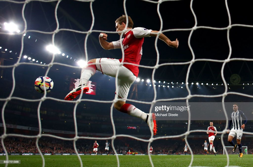 Nacho Monreal of Arsenal clears the ball from the goal line during the Premier League match between Arsenal and West Bromwich Albion at Emirates Stadium on September 25, 2017 in London, England.
