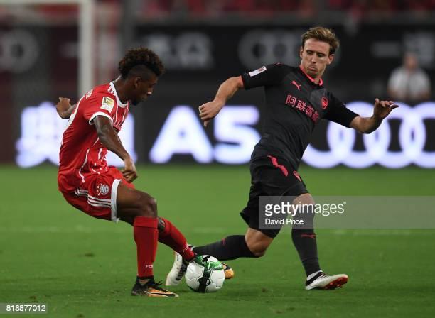Nacho Monreal of Arsenal closes down Kingsley Coman of Bayern during the match between Bayern Munichand Arsenal at Shanghai Stadium on July 19 2017...