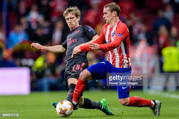 Nacho Monreal of Arsenal FC fights for the ball with Antoine Griezmann of Atletico de Madrid during the UEFA Europa League 201718 semifinals match...