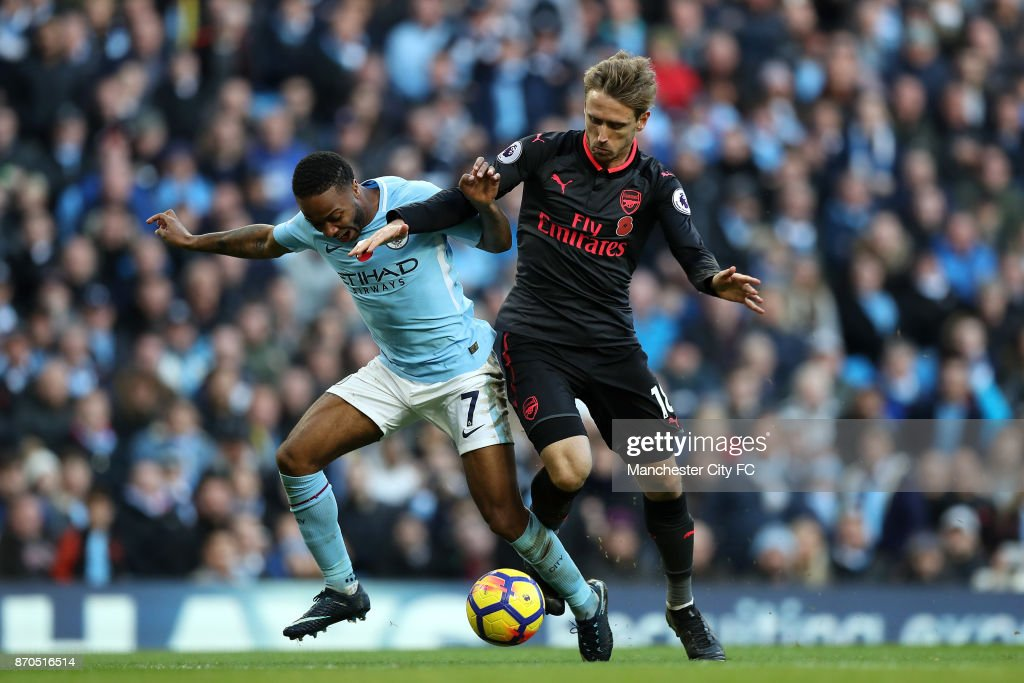 Nacho Monreal of Arsenal fouls Raheem Sterling of Manchester City and a penalty is awarded during the Premier League match between Manchester City and Arsenal at Etihad Stadium on November 5, 2017 in Manchester, England.