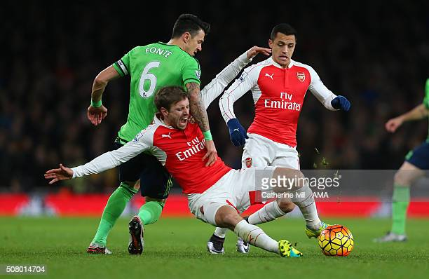 Nacho Monreal of Arsenal goes down as Jose Fonte of Southampton and Alexis Sanchez of Arsenal battle it out during the Barclays Premier League match...