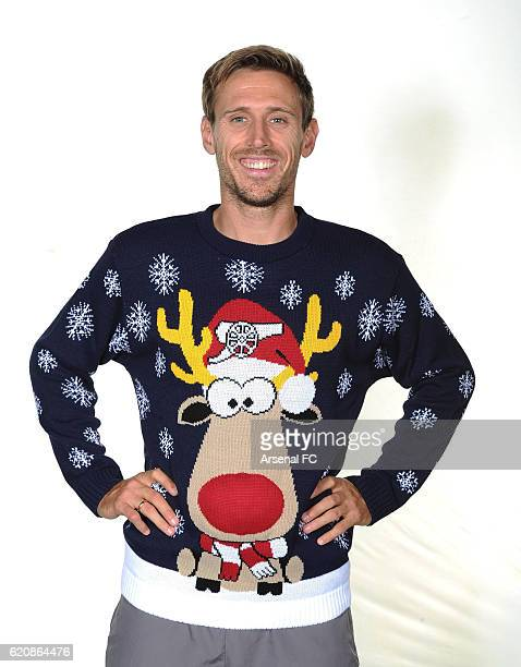 Nacho Monreal of Arsenal in his Arsenal Christmas Jumper to support Save the Children Christmas Jumper Day at London Colney on October 21 2016 in St...