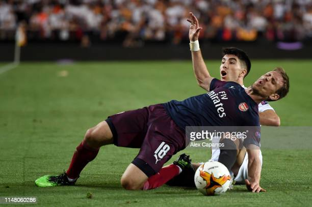 Nacho Monreal of Arsenal is challenged by Carlos Soler of Valencia during the UEFA Europa League Semi Final Second Leg match between Valencia and...
