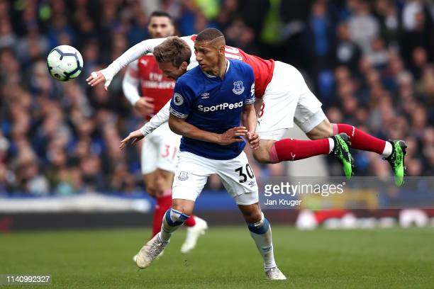 Nacho Monreal of Arsenal is challenged by Richarlison of Everton during the Premier League match between Everton FC and Arsenal FC at Goodison Park...