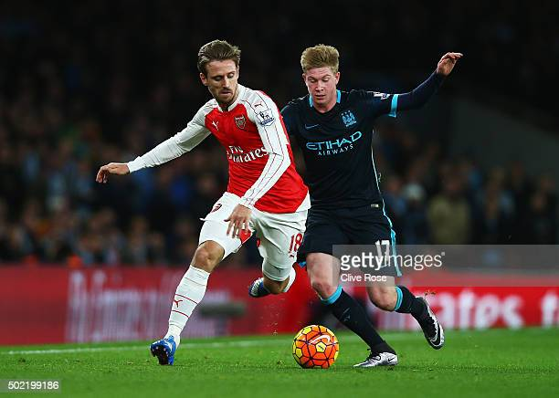 Nacho Monreal of Arsenal is closed down by Kevin de Bruyne of Manchester City during the Barclays Premier League match between Arsenal and Manchester...