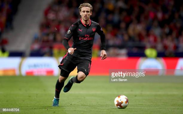 Nacho Monreal of Arsenal runs with the ball during the UEFA Europa League Semi Final second leg match between Atletico Madrid and Arsenal FC at...
