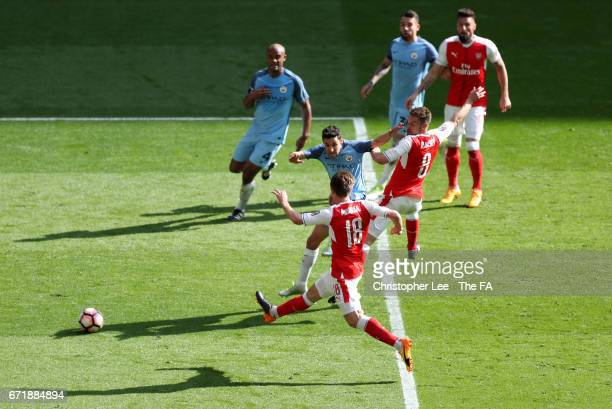Nacho Monreal of Arsenal scores his sides first goal during the Emirates FA Cup Semi-Final match between Arsenal and Manchester City at Wembley...