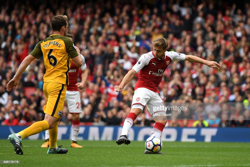 Nacho Monreal of Arsenal scores his sides first goal during the Premier League match between Arsenal and Brighton and Hove Albion at Emirates Stadium on October 1, 2017 in London, England.