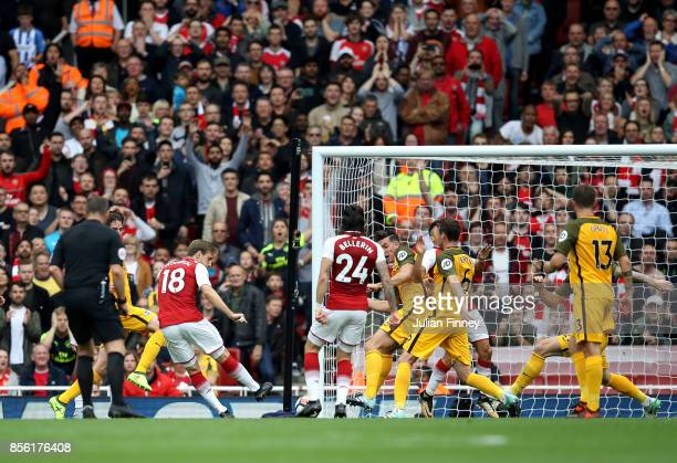 Nacho Monreal of Arsenal scores his sides first goal during the Premier League match between Arsenal and Brighton and Hove Albion at Emirates Stadium...