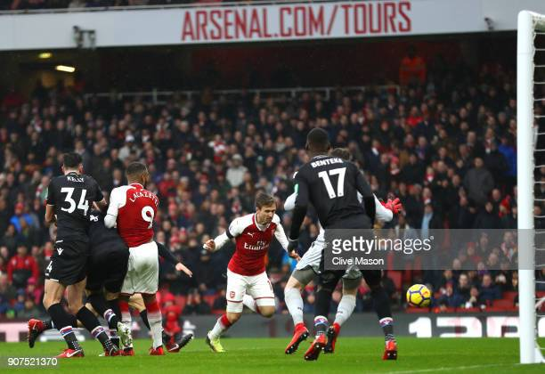 Nacho Monreal of Arsenal scores his sides first goal during the Premier League match between Arsenal and Crystal Palace at Emirates Stadium on...