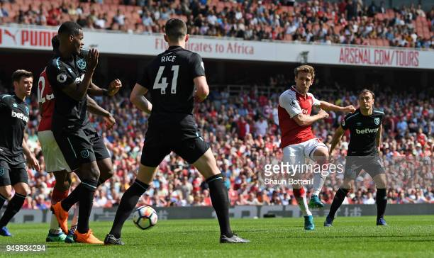 Nacho Monreal of Arsenal scores his sides first goal during the Premier League match between Arsenal and West Ham United at Emirates Stadium on April...
