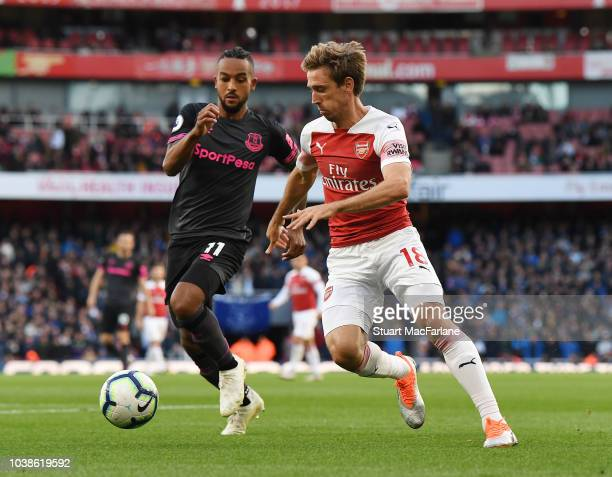 Nacho Monreal of Arsenal takes on Theo Walcott of Everton during the Premier League match between Arsenal FC and Everton FC at Emirates Stadium on...