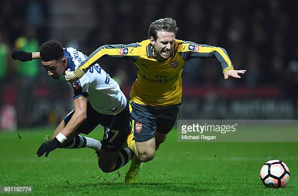 Nacho Monreal of Arsenal tangles with Callum Robinson of Preston North End during the Emirates FA Cup Third Round match between Preston North End and...