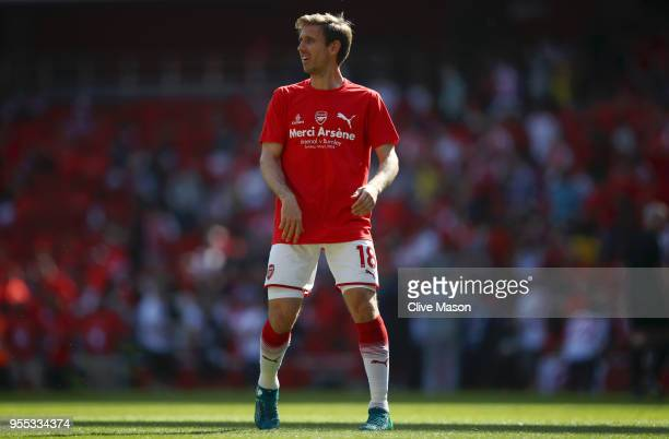 Nacho Monreal of Arsenal warms up whilst wearing a 'Merci Arsene' t shirt prior to the Premier League match between Arsenal and Burnley at Emirates...