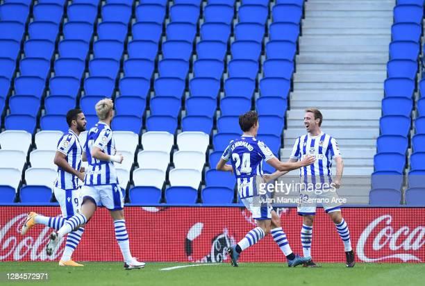 Nacho Monreal of Real Sociedad celebrates with teammates after scoring his team's first goal during the La Liga Santander match between Real Sociedad...