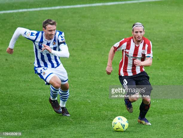 Nacho Monreal of Real Sociedad duels for the ball with Iker Muniain of Athletic Club during the La Liga Santander match between Athletic Club and...