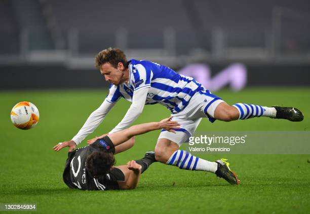 Nacho Monreal of Real Sociedad is tackled by Daniel James of Manchester United during the UEFA Europa League Round of 32 match between Real Sociedad...