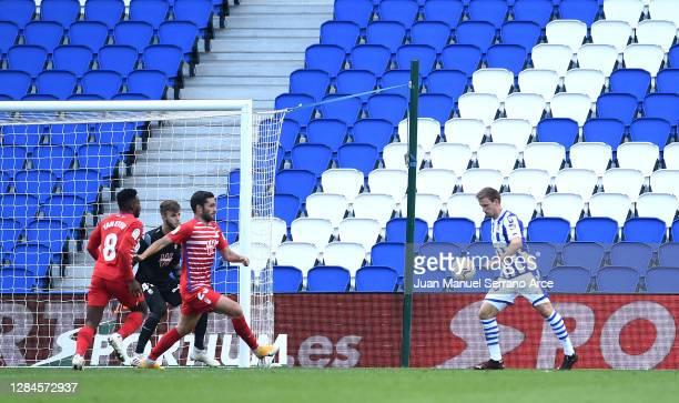 Nacho Monreal of Real Sociedad scores his team's first goal during the La Liga Santander match between Real Sociedad and Granada CF at Estadio Anoeta...